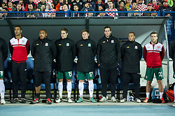 OSIJEK, CROATIA - Tuesday, October 16, 2012: Wales substitutes Lewin Nyatanga, goalkeeper Jason Brown, David Edwards, Simon Church, goalkeeper Owain Fon Williams, Ashley 'Jazz' Richards Adam Matthews line-up before the Brazil 2014 FIFA World Cup Qualifying Group A match at the Stadion Gradski Vrt. (Pic by David Rawcliffe/Propaganda)