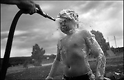 .11-year-old Thomas Lenaway get shaving cream blasted off his face with a garden hose at Camp Enchantment, a weeklong chance for New Mexico children who have been directly touched by cancer to get away from the stresses of their regular lives and just be kids.