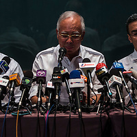 Malaysian Prime Minister Najib Razak (C) with his deputy Muhyiddin Yassin (L) and acting Transport Minister Hishamuddin Hussin during a press conference at Kuala Lumpur International Airport, Sepang, Selangor, Malaysia 8 May 2014. A Malaysia Airlines plane with 239 people on board went missing early 08 March 2014 while on its way to Beijing, the airline's chief executive said. Malaysia Airlines said in a statement that flight MH370 was carrying a total of 227 passengers, including two infants, and 12 crew members. A Malaysia Airlines official said 158 Chinese passengers were on the plane. The Boeing 777-200 aircraft was expected to land in Beijing at 6:30 am (22:30 GMT on 07 March). According to media reports passengers on missing flight were from 14 different nationalities: China, Malaysia, Indonesia, Australia, France, USA, New Zealand, Ukraine, Canada, Russia, Italy, Taiwan, the Netherlands and Austria.