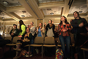"""Students clap and dance along with Lady Gaga's """"Poker Face"""" during the 6th Ava Nichols Faculty pageant in Baker University Ballroom on Wednesday, February 25. The event was hosted by Alpha Phi Omega and the proceeds will be given to Camp Equality Ohio, a program that provides a summer camp for children with cancer."""