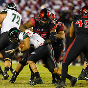24 November 2018: San Diego State Aztecs defensive lineman Noble Hall (95) tackles Hawaii Warriors running back Fred Holly III (21) in the back field for a loss in the first quarter. The Aztecs closed out the season with a 31-30 overtime loss to Hawaii at SDCCU Stadium.