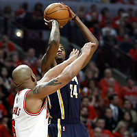 CHICAGO, IL - APR 18: Paul George #24 of the Indiana Pacers shoots the ball against Keith Bogans #6 of the Chicago Bulls during game 2 of the Eastern Conference First Round at the United Center on April 18, 2011 in Chicago, IL. NOTE TO USER: User expressly acknowledges and agrees that, by downloading and or using this photograph, User is consenting to the terms and conditions of the Getty Images License Agreement. Mandatory Credit: 2011 NBAE (Photo by Chris Elise/NBAE via Getty Images)