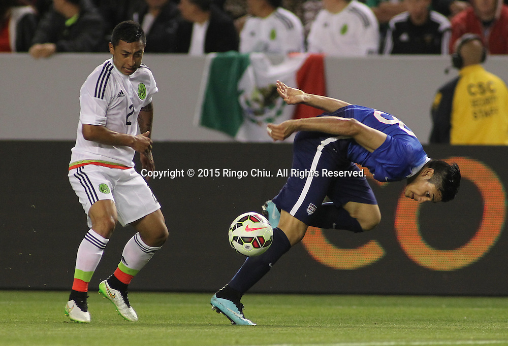 United States' Mario Rodriguez #18 actions against Mexico's Gil Bur—n #2 during a men's national team international friendly match, April 22, 2015, at StubHub Center in Carson, California. United States won 3-0. (Photo by Ringo Chiu/PHOTOFORMULA.com)