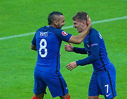 PARIS, FRANCE - Sunday, July 3, 2016: France's Antoine Griezmann celebrates scoring the fourth goal against Iceland with team-mate Dimitri Payet during the UEFA Euro 2016 Championship Semi-Final match at the Stade de France. (Pic by Paul Greenwood/Propaganda)