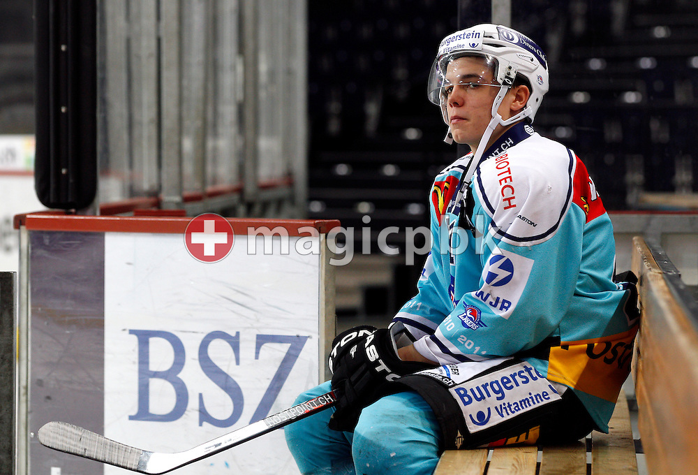 Rapperswil-Jona Lakers forward Reto SURI sits on a bench while waiting to be interviewed after a National League A ice hockey game between ZSC Lions and Rapperswil-Jona Lakers held at Hallenstadion in Zurich, Switzerland, Sunday, Dec. 12, 2010. (Photo by Patrick B. Kraemer / MAGICPBK)