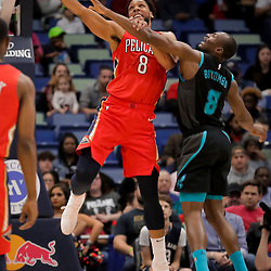 Apr 3, 2019; New Orleans, LA, USA;  New Orleans Pelicans center Jahlil Okafor (8) dunks over Charlotte Hornets center Bismack Biyombo (8) during the first quarter at the Smoothie King Center. Mandatory Credit: Derick E. Hingle-USA TODAY Sports