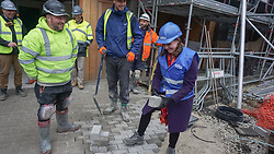 © Licensed to London News Pictures. 22/11/2019. Sheffield, UK. Liberal Democrat Leader Jo Swinson, attempts some block paving as she visits the Little Kelham eco house building project during a General Election campaign trail stop in Sheffield. Britain will go to the polls on December 12, 2019 to vote in a pre-Christmas general election. Photo credit: Ioannis Alexopoulos /LNP