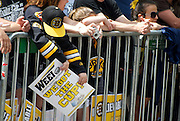 June 18, 2011, Boston, MA - A young fan waits for the parade to begin. Photo by Lathan Goumas.