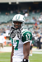 Sep 25, 2011; Oakland, CA, USA;  New York Jets wide receiver Plaxico Burress (17) warms up before the game against the Oakland Raiders at O.co Coliseum. Oakland defeated New York 34-24.