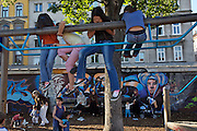 SOHO in Ottakring. Yppenpark. Migrant kids at the play area..Now in its 9th year, SOHO in Ottakring is an established art festival in public spaces of Vienna's 16th city district. In cooperation with the local community, up to 200 artists take part in the annual festival at the end of May/beginning of June. The festival is a huge success and has helped develop the formerly neglected and decaying district into a sprawling, 'hip' urban area. More info in German at: www.sohoinottakring.at
