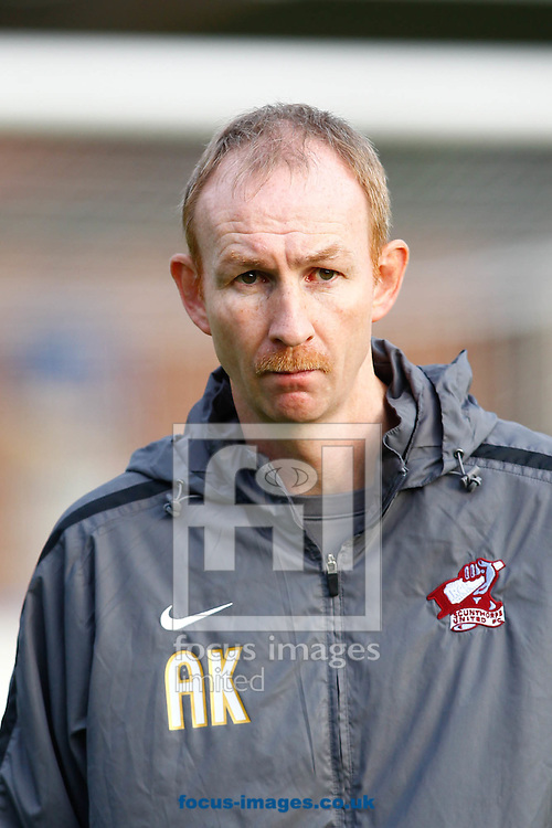 Picture by Andrew Tobin/Focus Images Ltd. 07710 761829 .12/11/11..  Alan Knill, manager of Scunthorpe United looks on during the FA Cup first round match netween AFC Wimbledon and Scunthorpe United at The Cherry Red Records Fans' stadium, Kingston Upon Thames, Surrey.