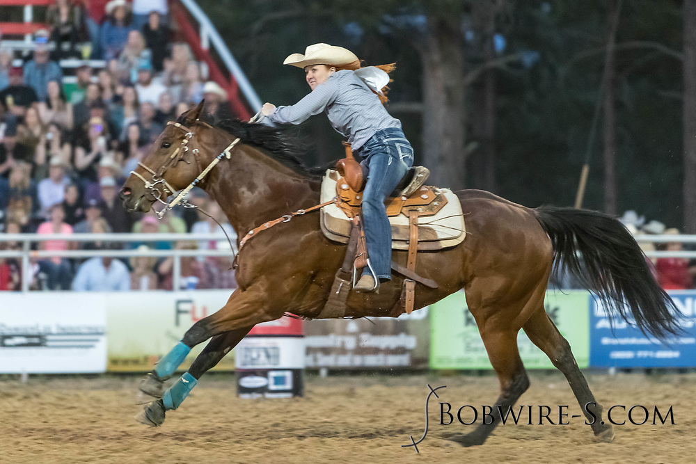 Callie Colden makes her run in the barrel racing during the second performance of the Elizabeth Stampede on Saturday, June 2, 2018.