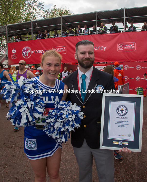 A runner dressed as an Italian cheerleader is awarded her Guinness World Record on The Mall. The Virgin Money London Marathon, 23rd April 2017.<br /> <br /> Photo: Roger Allen for Virgin Money London Marathon<br /> <br /> For further information: media@londonmarathonevents.co.uk