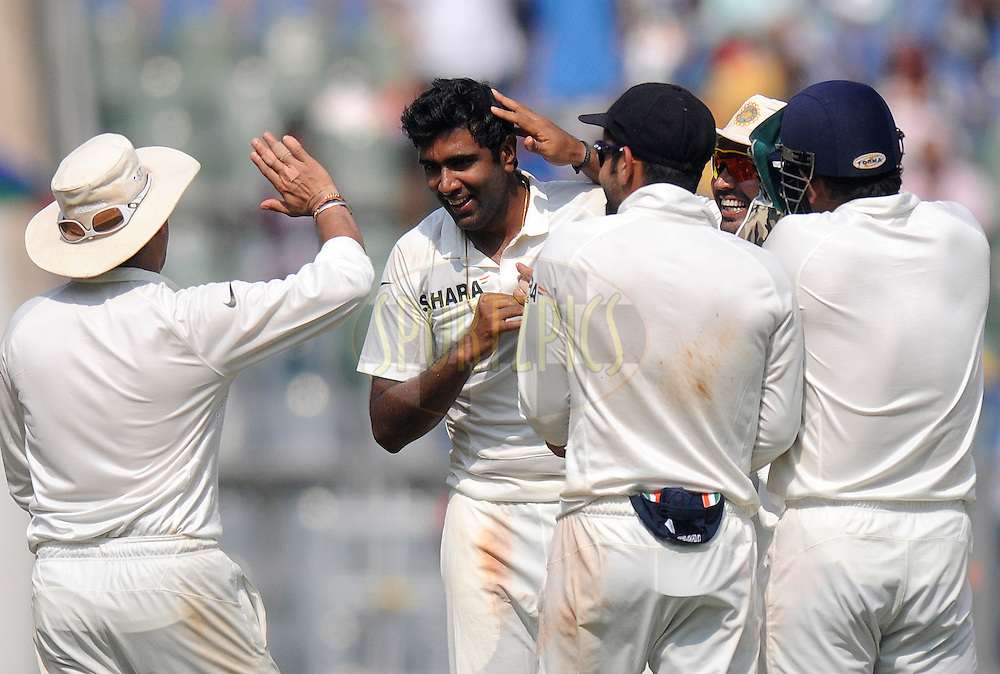 Ravichandran AShwin of India celebrates the wicket of Narsingh Deonarine of West Indies during day one of the second Star Sports test match between India and The West Indies held at The Wankhede Stadium in Mumbai, India on the 14th November 2013<br /> <br /> This test match is the 200th test match for Sachin Tendulkar and his last for India.  After a career spanning more than 24yrs Sachin is retiring from cricket and this test match is his last appearance on the field of play.<br /> <br /> Photo by: Pal PIllai - BCCI - SPORTZPICS<br /> <br /> Use of this image is subject to the terms and conditions as outlined by the BCCI. These terms can be found by following this link:<br /> <br /> http://sportzpics.photoshelter.com/gallery/BCCI-Image-Terms/G0000ahUVIIEBQ84/C0000whs75.ajndY