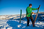A skier removes a skin from his skis after uphilling on Buttermilk Mountain in Aspen, Colorado.