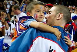 Nando de Colo of France with his son at medal ceremony after the final basketball game between National basketball teams of Spain and France at FIBA Europe Eurobasket Lithuania 2011, on September 18, 2011, in Arena Zalgirio, Kaunas, Lithuania. Spain defeated France 98-85 and became European Champion 2011, France placed second and Russia third. (Photo by Vid Ponikvar / Sportida)