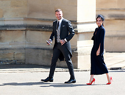 British fashion designer Victoria Beckham (R) and her husband, British former soccer player David Beckham arrive for the royal wedding ceremony of Britain's Prince Harry and Meghan Markle at St George's Chapel in Windsor Castle, in Windsor, Britain, 19 May 2018. Photo by Lauren Hurley/ABACAPRESS;COM