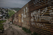 Much of Tijuana is blocked off from the United States by a double wall/fence.  In the 1980's, this portion of Otay Mesa and Otay Canyon had no border wall at all. Tijuana, Mexico.