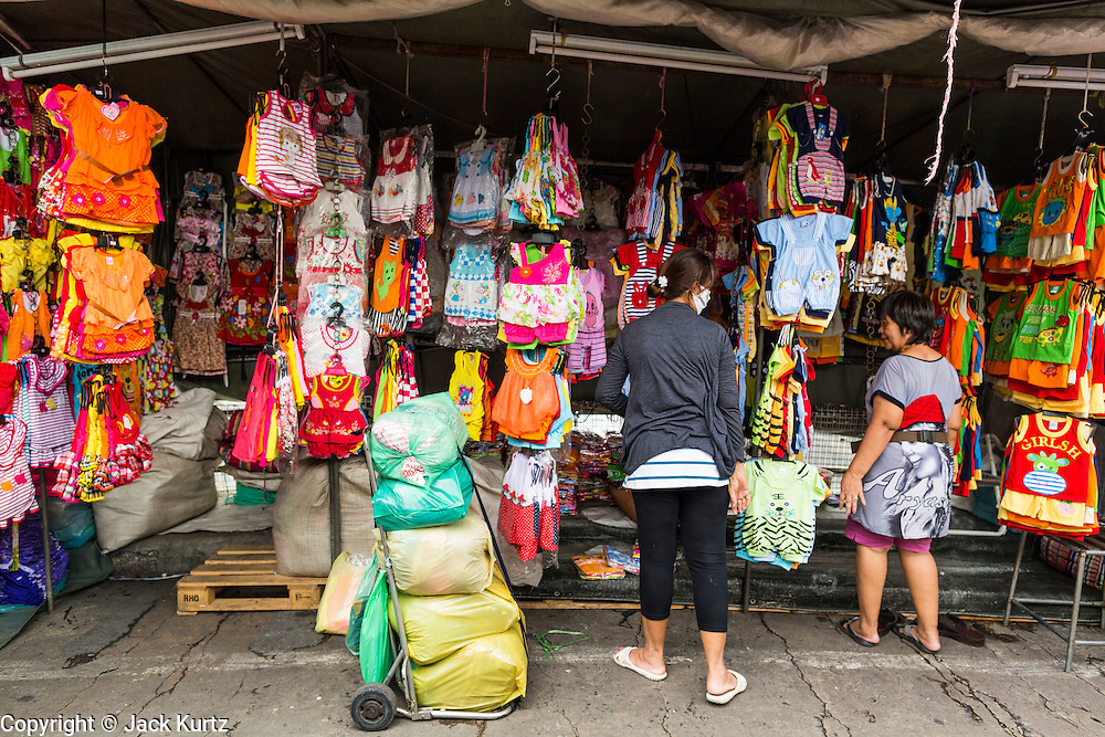 06 JUNE 2013 - BANGKOK, THAILAND:     A clothing vendor in Bobae Market in Bangkok. Bobae Market is a 30 year old market famous for fashion wholesale and is now very popular with exporters from around the world. Bobae Tower is next to the market and  advertises itself as having 1,300 stalls under one roof and claims to be the largest garment wholesale center in Thailand.       PHOTO BY JACK KURTZ