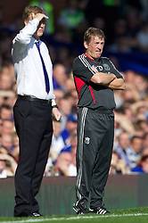 LIVERPOOL, ENGLAND - Saturday, October 1, 2011: Liverpool's manager Kenny Dalglish and Everton's manager David Moyes during the Premiership match at Goodison Park. (Pic by Vegard Grott/Propaganda)