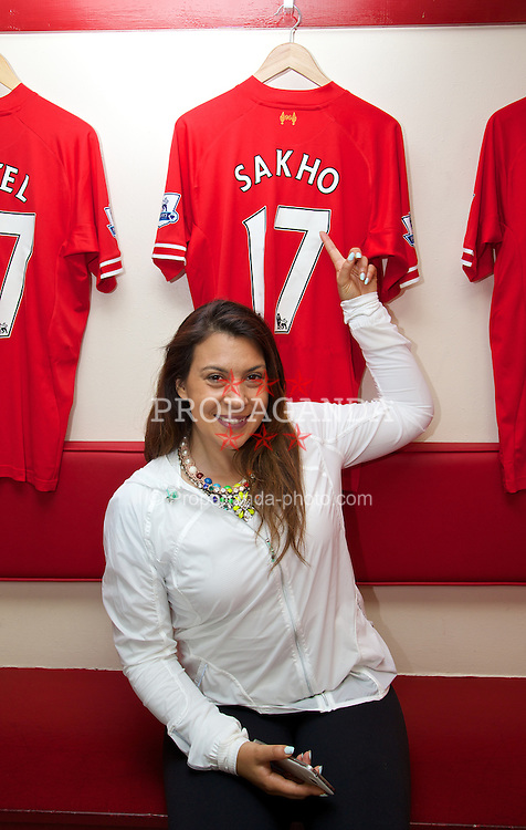 LIVERPOOL, ENGLAND - Saturday, June 21, 2014: Wimbledon champion Marion Bartoli with the shirt of French player Mamadou Sakho on a visit to Anfield during Day Three of the Liverpool Hope University International Tennis Tournament. (Pic by David Rawcliffe/Propaganda)