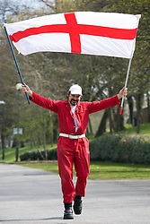 © Licensed to London News Pictures. 23/04/2015. Nottingham, UK. The Nottingham St George's parade took part today. The parade met in Forest Recreation Ground. An estimated two hundred people with trucks playing patriotic music and horses dressed in flags made their way along the streets into the City Centre. Pictured, one man and his flag. Photo credit : Dave Warren/LNP