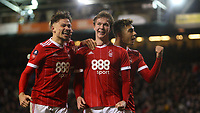 Kieron Dowell is mobbed after securing the win after another late Forest penalty  during The Emirates FA Cup Third Round match between Nottingham Forest and Arsenal at City Ground on January 7, 2018 in Nottingham, England.