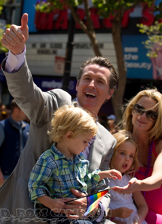 Calif. Lt. Gov. Gavin Newsom gives the thumbs up to the crowd as he rides along Market Street with his wife and children, at the 43rd annual San Francisco Pride parade, Sunday, June 30, 2013 in San Francisco. (Photo by D. Ross Cameron)