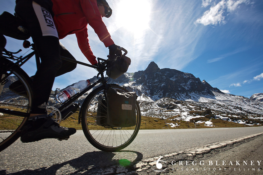 A cyclist on a high pass in the Swiss Alps