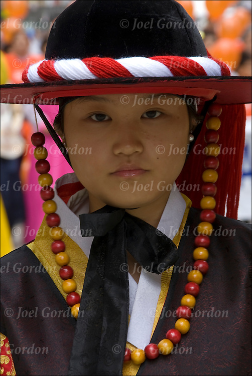Annual Korean Harvest Parade in New York City. Portrait of  young Korean-American woman wearing traditional folk  costume celebrating her ethnic pride.