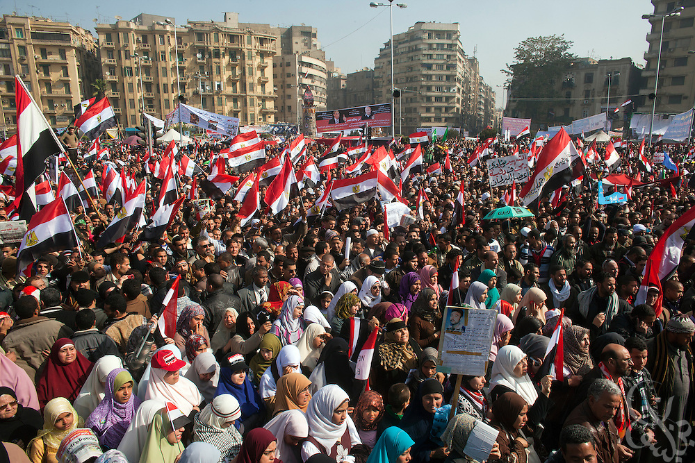 Hundreds of thousands of Egyptian men, women and children celebrate the one anniversary of the Egyptian revolution in Tahrir Square January 25, 2012 in Cairo, Egypt.