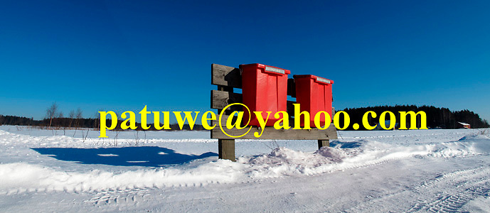 Scandinavia Finnish red letter post mail boxes in winter snow