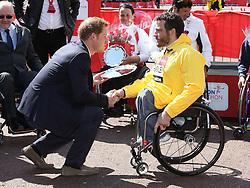 Prince Harry with Kurt Fearnley, winner of the mens elite wheelchair race at the London Marathon, Sunday 21st  April 2013 Photo by: Stephen Lock / i-Images