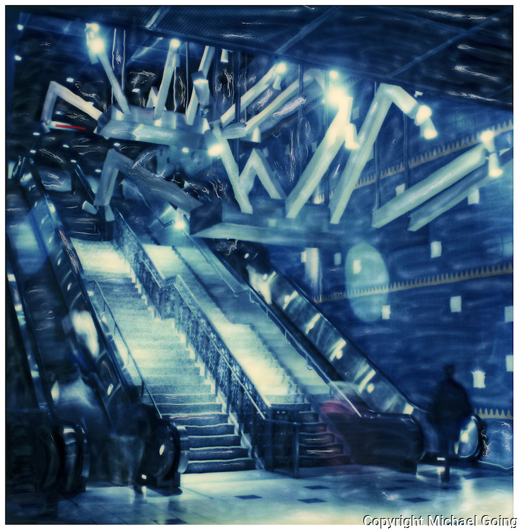 Altered Polaroid of the interior of Universal City Station, Metro Red Line featuring escalator and ceiling sculpture