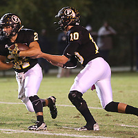 Lauren Wood | Buy at photos.djournal.com<br /> Pontotoc quarterback Jacob Carter hands the ball off to Gabe Harmon during Friday night's game against Itawamba.
