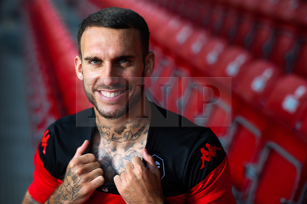 "© Licensed to London News Pictures . 29/07/2019. Salford , UK . Team captain LIAM HOGAN in a stand shows "" Live Your Dreams "" tattoo . Salford Football Club hold a pre-season photocall at the Peninsula Stadium , Moor Lane . Photo credit : Joel Goodman/LNP"