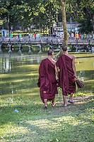Monks strolling around at Kandawgyi Lake, Yangon, Burma.