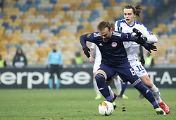 February 21, 2019 - Kiev, Ukraine - Olympiakos' Bibras Natcho, left, and Dynamo Kiev's Mykola Shaparenko, right, in the fight for the ball during the second leg of the Europa League football match of the 32nd stage between Dynamo Kiev and Olympiacos at the Olympic Stadium in Kiev. Ukraine, Thursday, February 21, 2019  (Credit Image: © Danil Shamkin/NurPhoto via ZUMA Press)