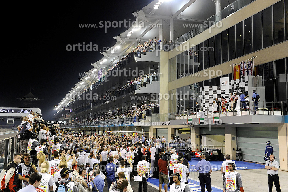 13.11.2011, Yas-Marina-Circuit, Abu Dhabi, UAE, Grosser Preis von Abu Dhabi, im Bild Podium - Fernando Alonso (ESP), Scuderia Ferrari - Lewis Hamilton (GBR), McLaren F1 Team - Jenson Button (GBR),  McLaren F1 Team  // during the Formula One Championships 2011 Large price of Abu Dhabi held at the Yas-Marina-Circuit, 2011/11/12. EXPA Pictures © 2011, PhotoCredit: EXPA/ nph/ Dieter Mathis..***** ATTENTION - OUT OF GER, CRO *****