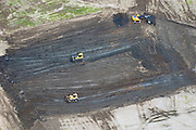 Aerial view of  bull dozers. Catapiller Heavy Equipment moving dirt