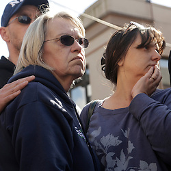 Barbara Welsh (L), whose husband is missing, listens to a press conference  in Arlington, Washington as rescuers search for people still missing from a landslide March 23, 2014. Three people died and at least eight others were injured on Saturday in a after a large mudslide blocked Highway 530 near Oso, Washington and destroyed six or more homes in northwest Washington state, officials said. REUTERS/Jason Redmond (UNITED STATES)