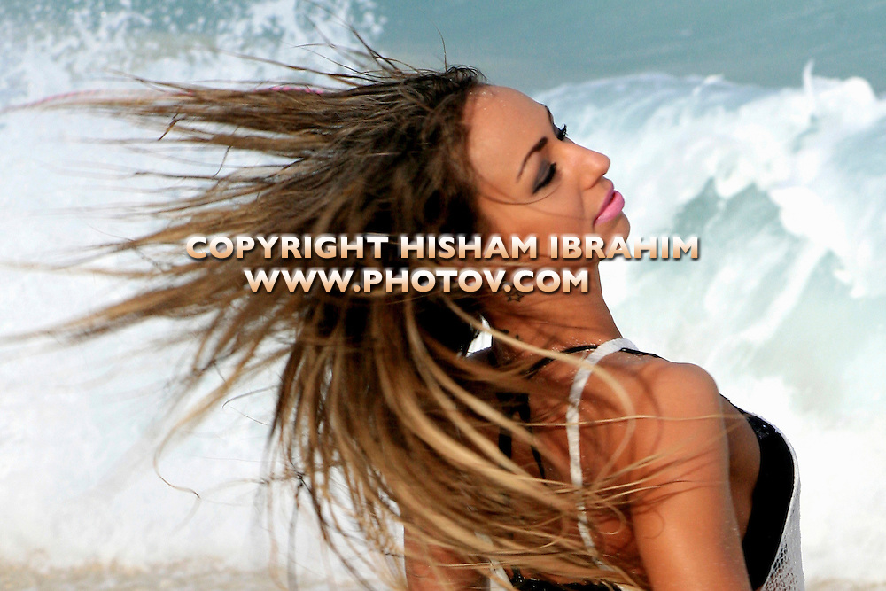 Young happy woman dancing on the beach, Cancun, Mexico