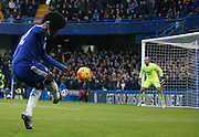 Chelsea attacker Willian fires a cross in to the area during the Barclays Premier League match between Chelsea and Everton at Stamford Bridge, London, England on 16 January 2016. Photo by Andy Walter.