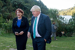 Britain's Foreign Secretary Boris Johnson, right, with Minister of Conservation Maggie Barry walk through at Zealandia bird park in Wellington, New Zealand on July 25, 2017.   <br /> Pool/AFP/Marty Melville