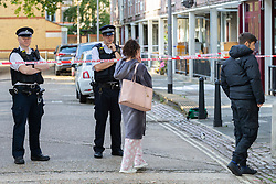 Tearful friends of the victim visit the crime scene at Munster Square in Camden where a 16 year-old teenager was stabbed to death. London, August 13 2019.