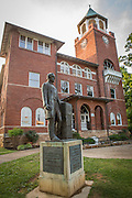 A statue of William Jennings Bryan in front of the the still active yet preserved courtroom in the Rhea County courthouse, in Dayton tennessee where the Scopes trial occured in 1925.. In that year, a high school teacher, John Scopes, was accused of violating Tennessee's Butler Act, which made it unlawful to teach human evolution in any state-funded school. <br /> The trial served its purpose of drawing intense national publicity, as national reporters flocked to Dayton to cover the big-name lawyers who had agreed to represent each side. William Jennings Bryan, three-time presidential candidate for the Democrats, argued for the prosecution, while Clarence Darrow, the famed defense attorney, spoke for Scopes. The trial publicized the Fundamentalist–Modernist Controversy which set modernists, who said evolution was consistent with religion, against fundamentalists who said the word of God as revealed in the Bible took priority over all human knowledge. The case was thus seen as both a theological contest and a trial on whether modern science regarding the creation-evolution controversy should be taught in schools.