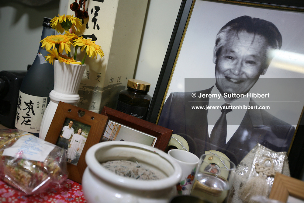 Photographs of Shoko Tendo's father Hiroyasu, (now deceased), sits a shrine, in the home of her sister Maki, in Honjo near Tokyo, Japan, Saturday, Sept. 1st, 2007. Shoko Tendo, daughter of Yakuza boss Hiroyasu Tendo (now deceased) has written an autobiographical book - 'Yakuza Moon',  describing her life growing up with a Yakuza criminal boss for a father, of her addiction to drugs, and the failed, and often violent sexual relationships she had with men. Shoko Tendo has a body covered in Yakuza style tattoos, including a large depiction of the Muromachi-period courtesan Jigoku Dayu (with a dagger clenched in her teeth), on her back. Shoko Tendo now lives in Tokyo with her 2 year old daughter Komachi.