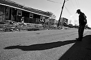 The lower ninth ward of New Orleans sits empty of it's population  six months after hurricane Katrina. Mardis Gras celebrations have begun in the city.