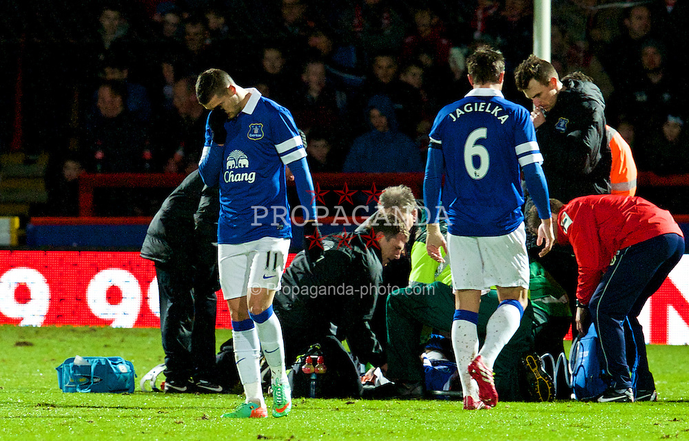 STEVENAGE, ENGLAND - Saturday, January 25, 2014: Everton's Kevin Mirallas cannot look as team-mate Bryan Oviedo lies injured during the FA Cup 4th Round match against Stevenage at Broadhall Way. (Pic by Tom Hevezi/Propaganda)