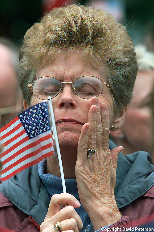 A woman in Des Moines, Ia.,  pauses for a moment of prayer and reflection during a rally following 9/11.  The terrorist attack on the U.S., brought citizens together in a show of unity and patriotism.